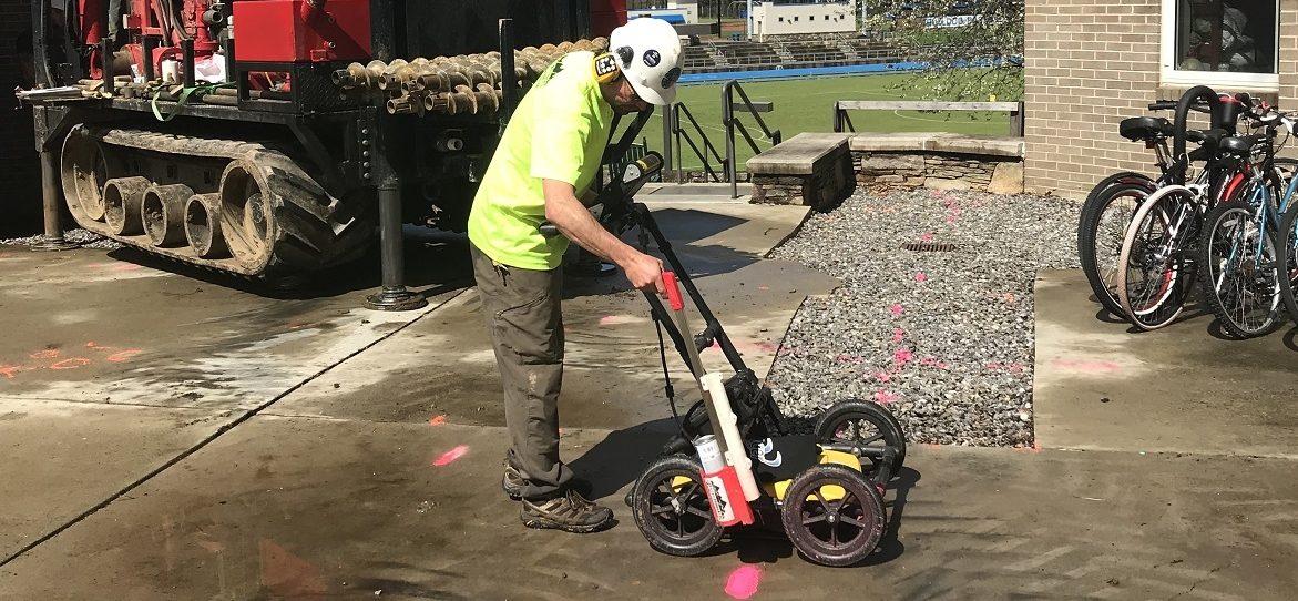 Technician using GPR to mark underground utilities