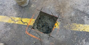 square saw cut in pavement - ready for drilling