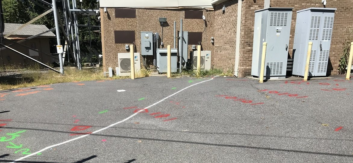 Utility marks at cell tower station.