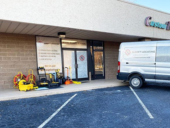 Target Locating storefront showing company van and locating equipment